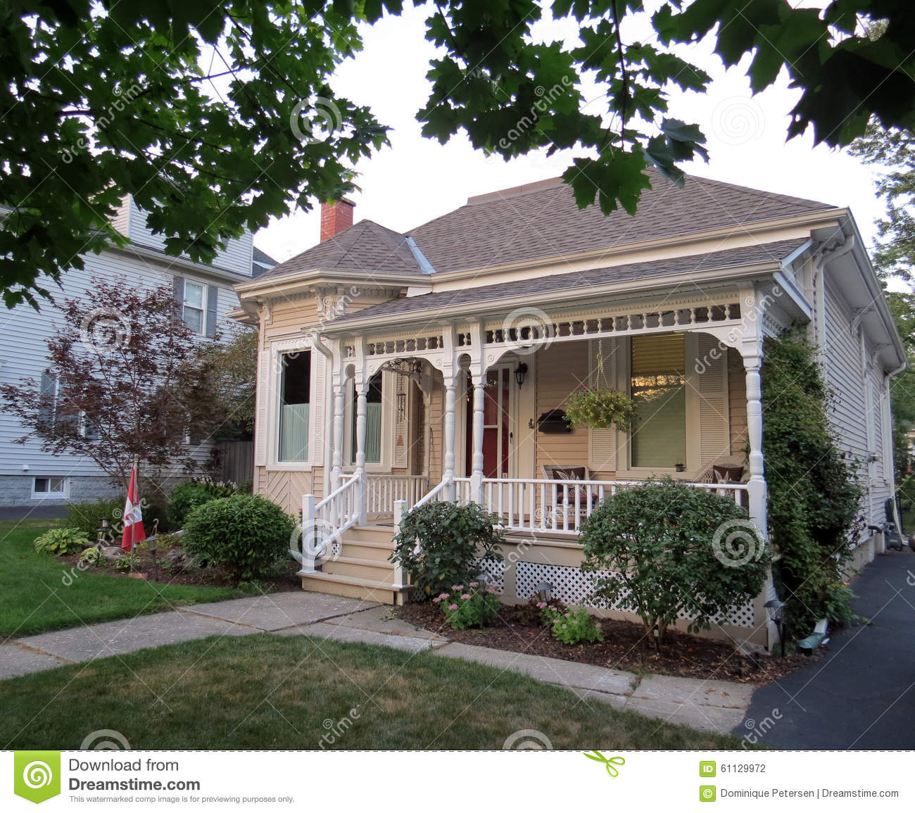 Front Porch Of Yellow House Stock Photo: Vintage Home Stock Photo