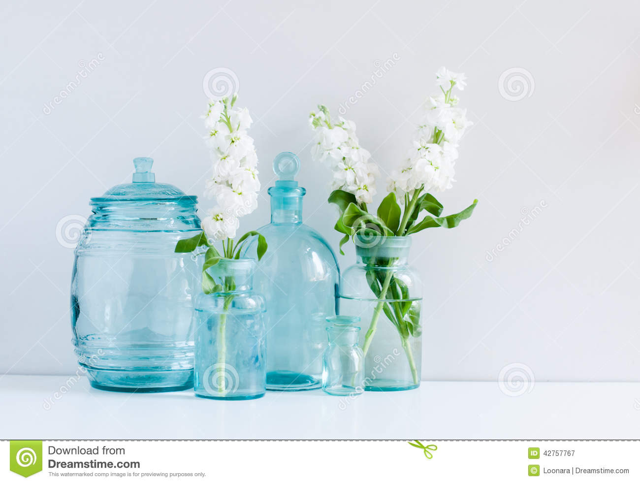 Vintage home decor stock photo image 42757767 for Flowers in glass bottles