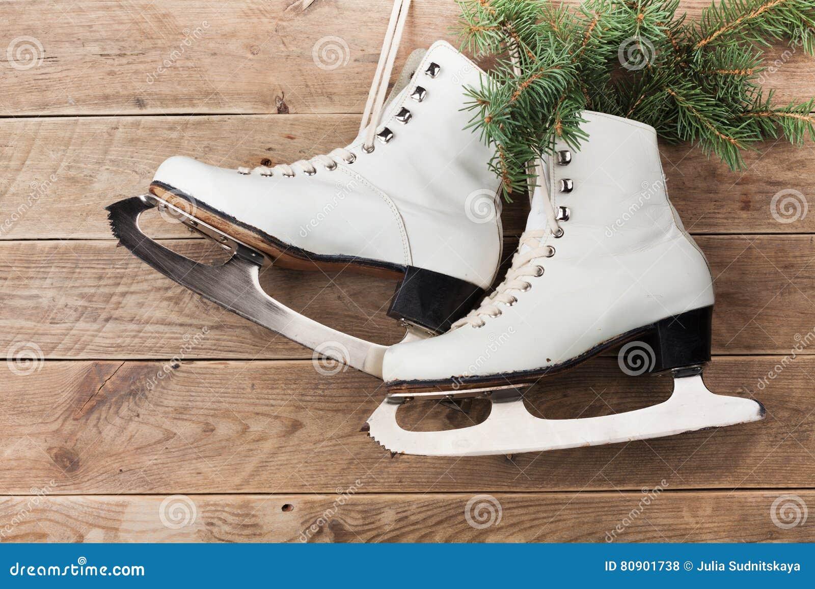 Roller skates for figure skating - Vintage Ice Skates For Figure Skating With Fir Tree Branch Hanging On Rustic Background Christmas