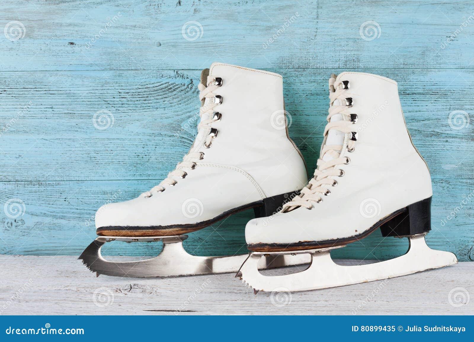 Roller skates for figure skating - Vintage Ice Skates For Figure Skating On Turquoise Background