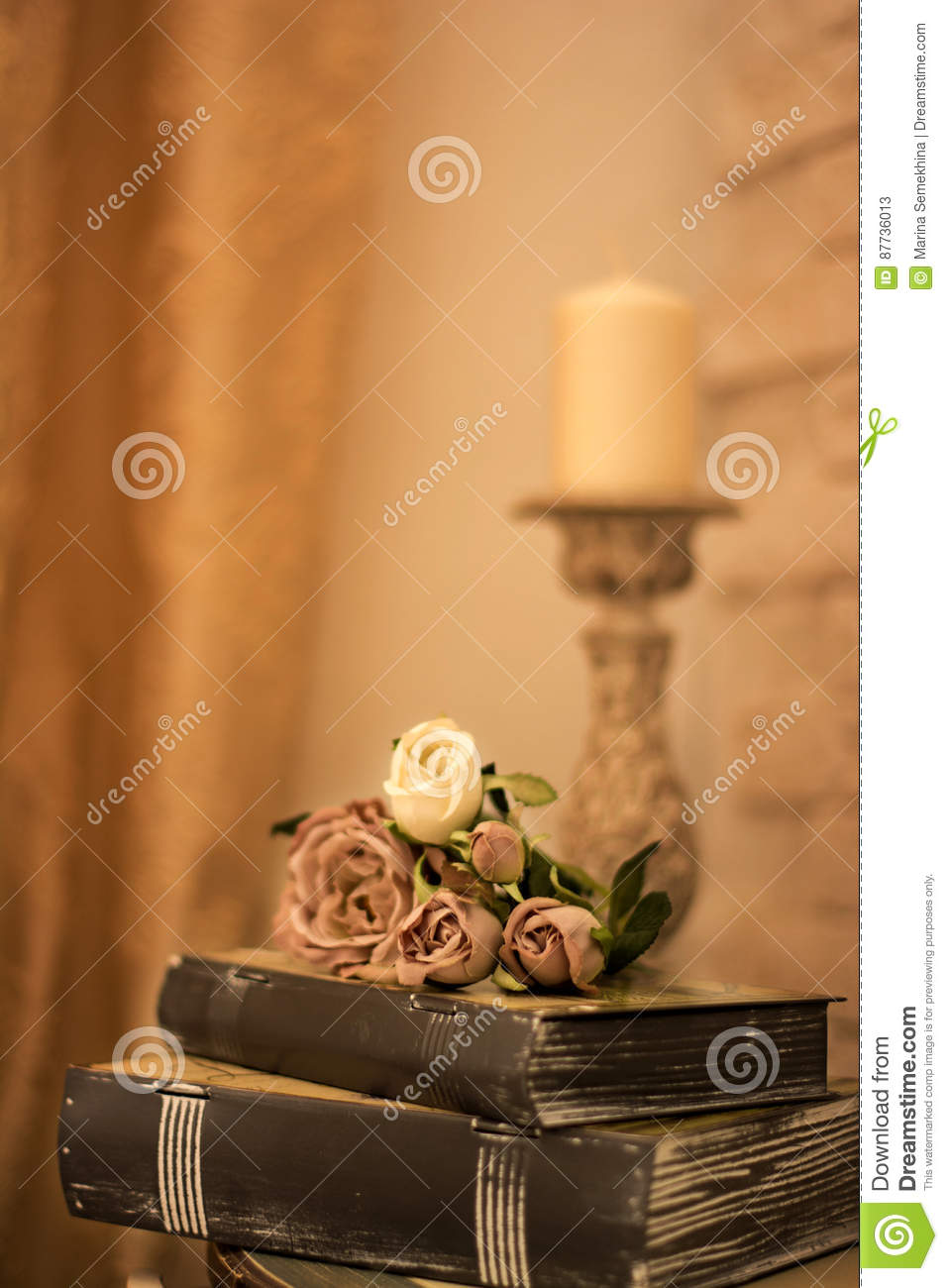 Vintage interior with a table with a vase and flovers and candles.