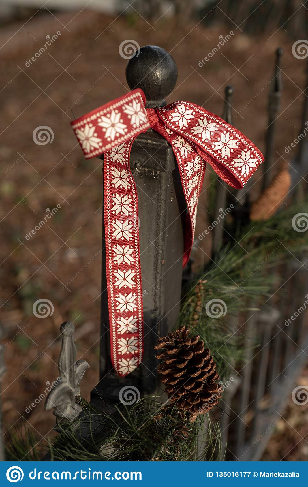 Image of: Vintage Iron Fence Pine Tree Garland Pine Cone Red Ribbon Decoration Stock Image Image Of Earth Green 135016177