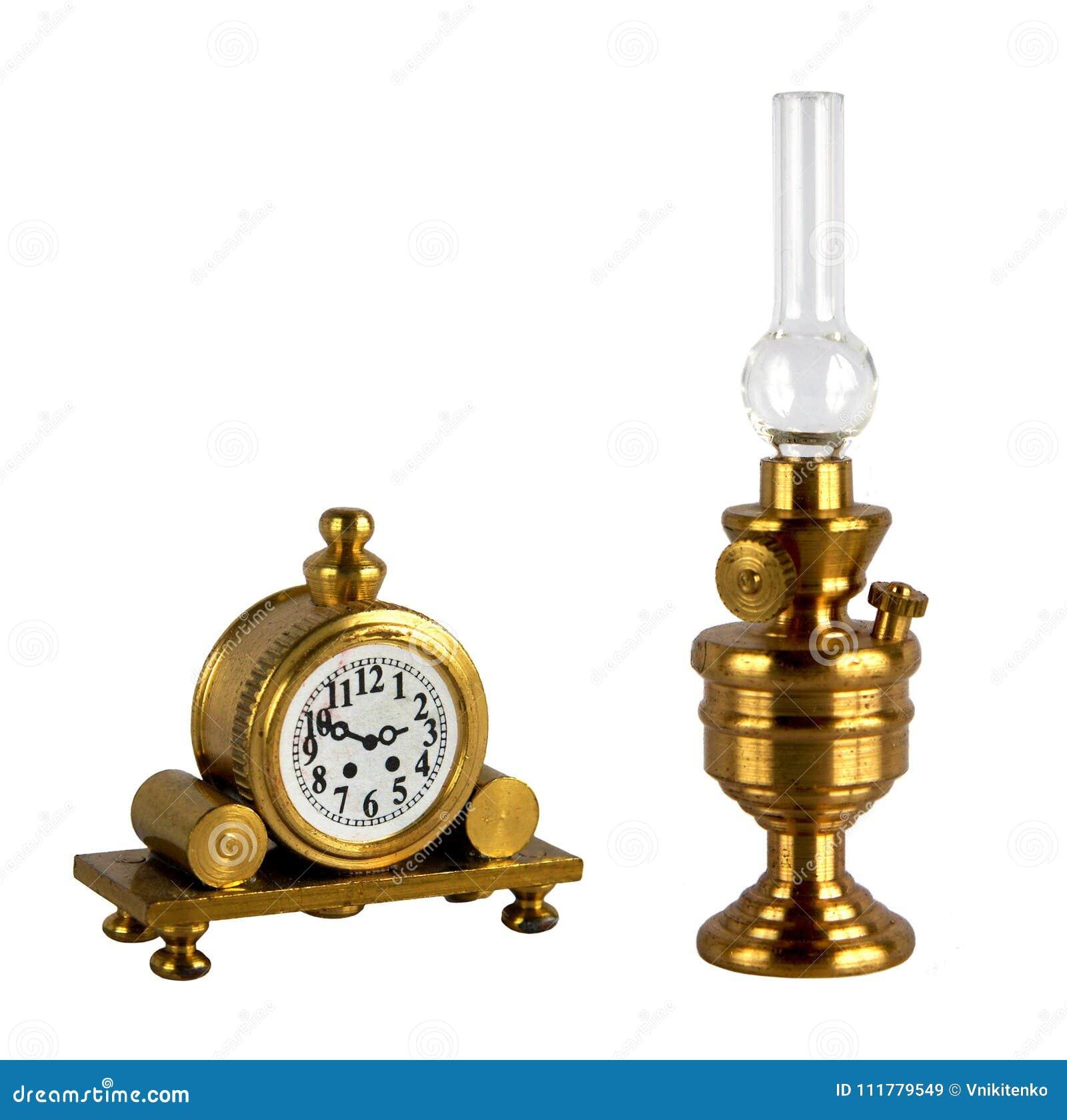 Vintage kerosene lamp and mantel clock
