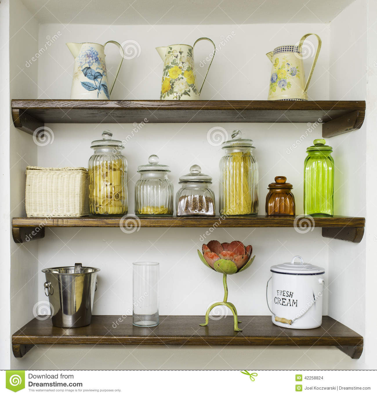 Vintage Kitchen Shelves With Jars, Jugs And Pots Stock