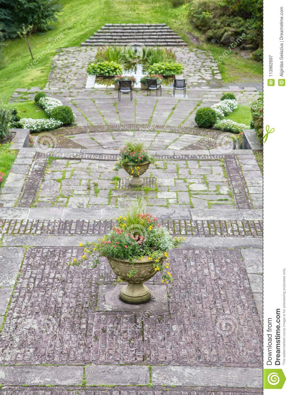 Concrete Garden Pots Vintage large concrete garden pots with flowers and three chairs vintage large concrete garden pots with flowers and three chairs on a concrete pavement in an old park workwithnaturefo