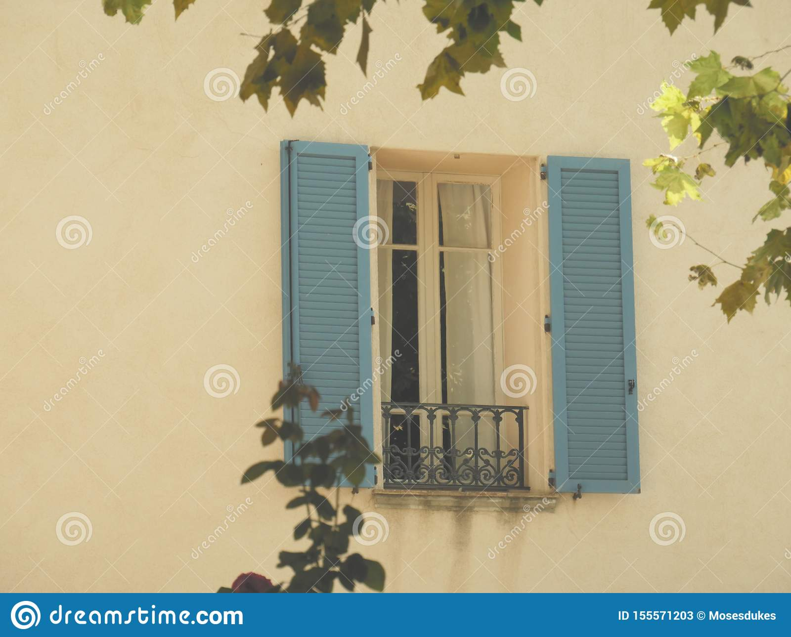 Vintage Looking French Window With Cyan Blue Shutters Stock