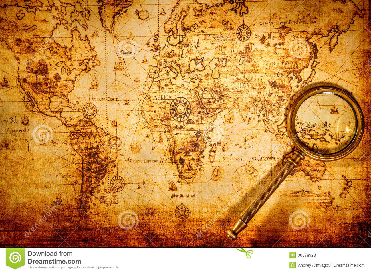 Vintage magnifying glass lies on an ancient world map stock photo vintage magnifying glass lies on an ancient world map grunge nautical gumiabroncs