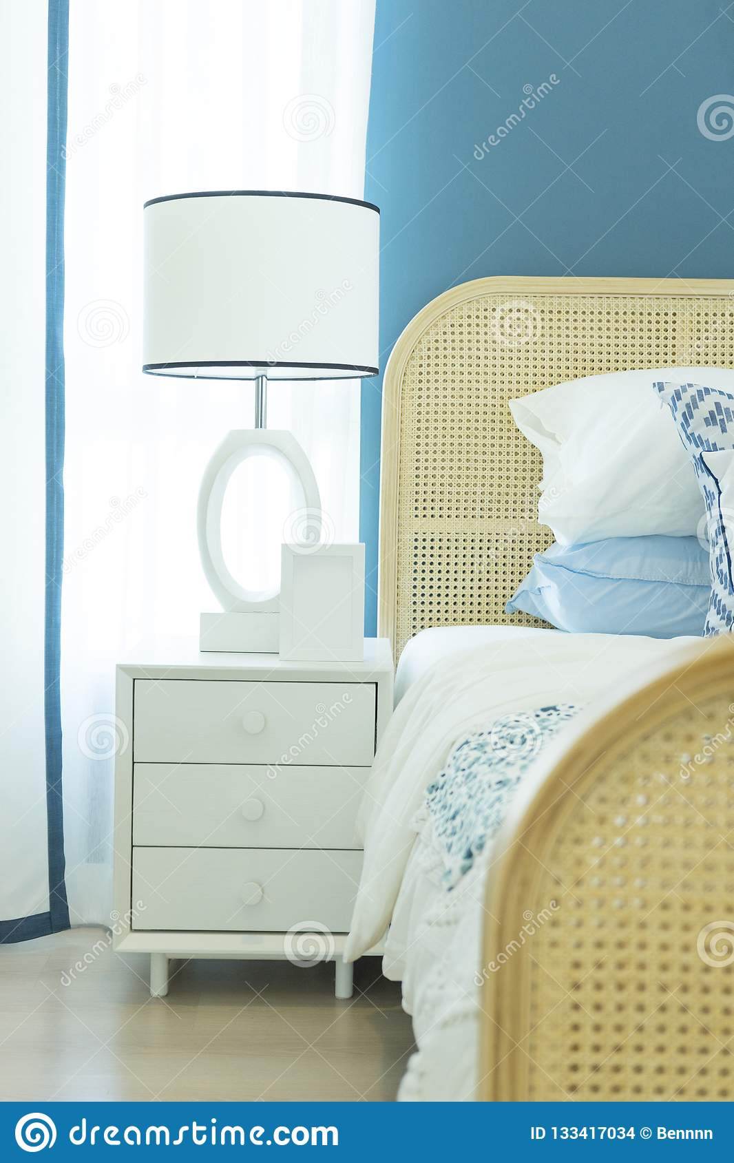 Master Bedroom With Blue Wall And White Table Lamp Stock Photo Image Of Pillow Bedroom 133417034