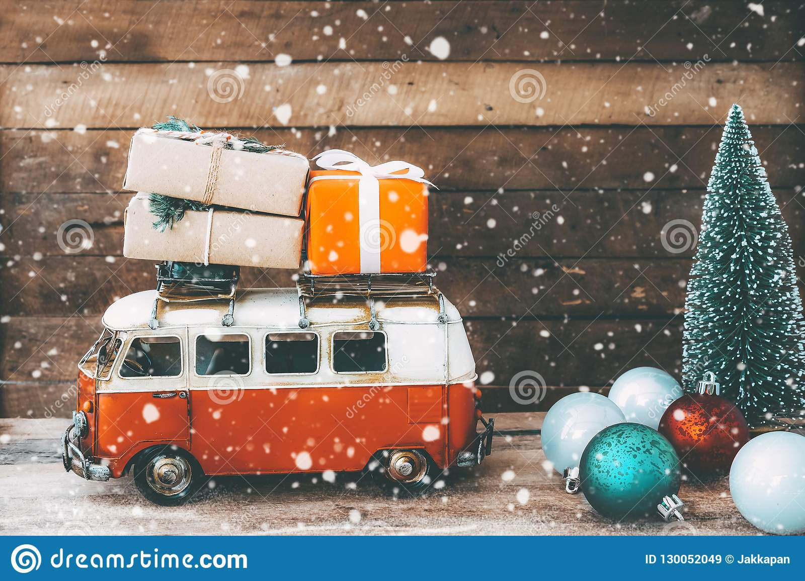 vintage merry christmas postcard background miniature antique car carrying presents gift box roof christmas tree snowy 130052049