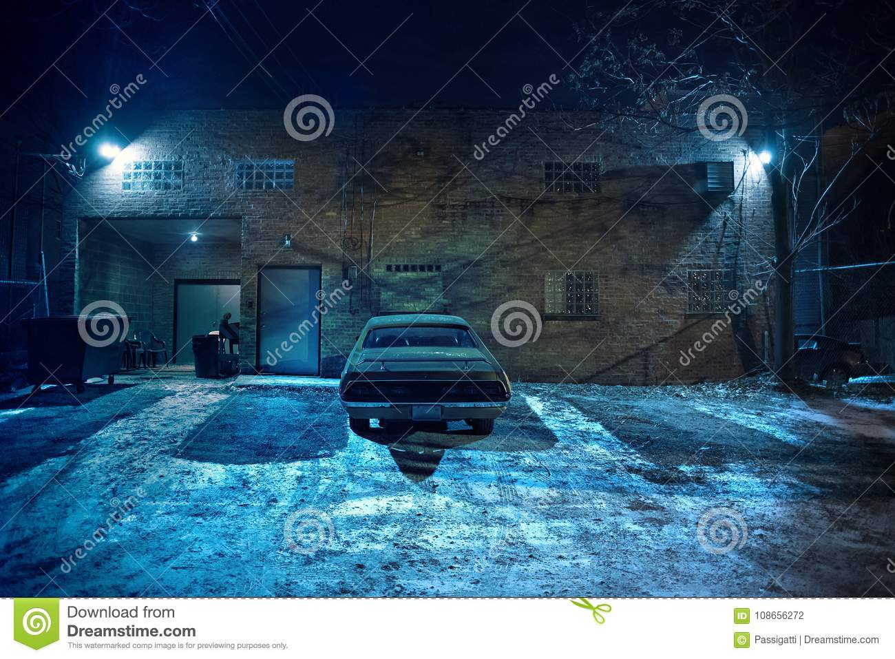 Vintage Muscle Car In A Dark Chicago City Urban Alley Stock Photo