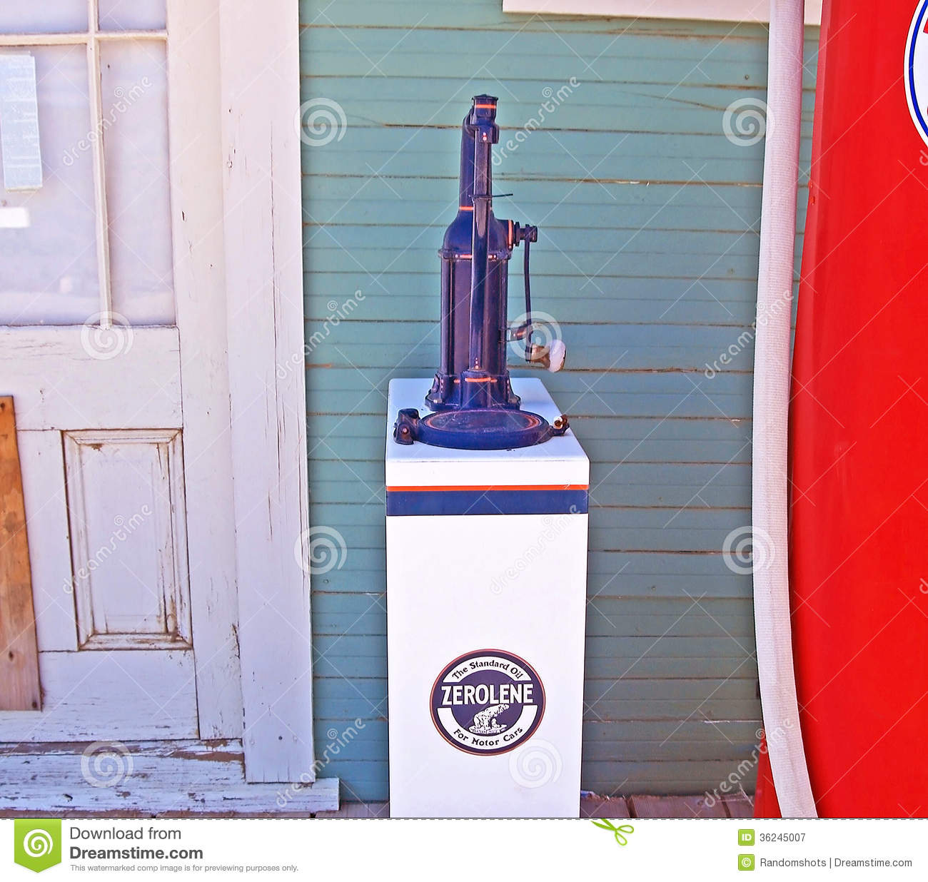 Vintage oil dispenser editorial photography image of for Wholesale motor oil prices
