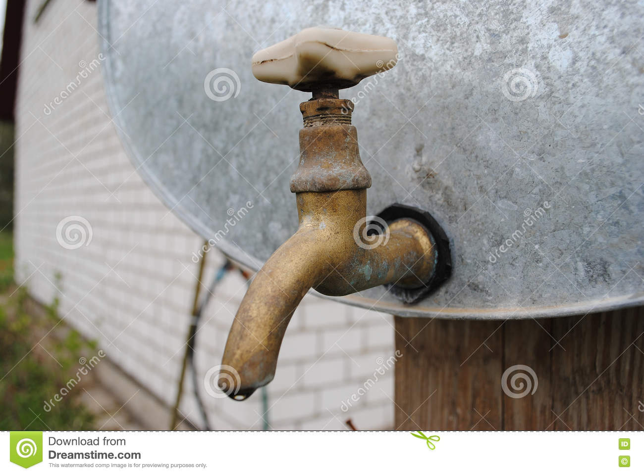 Vintage Old Brass Water Tap On A Galvanized Water Tank Stock Image