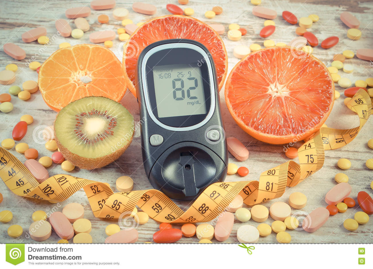 Vintage photo, Glucometer with result, centimeter, fruits and medical pills, diabetes, slimming, healthy lifestyle and nutrition
