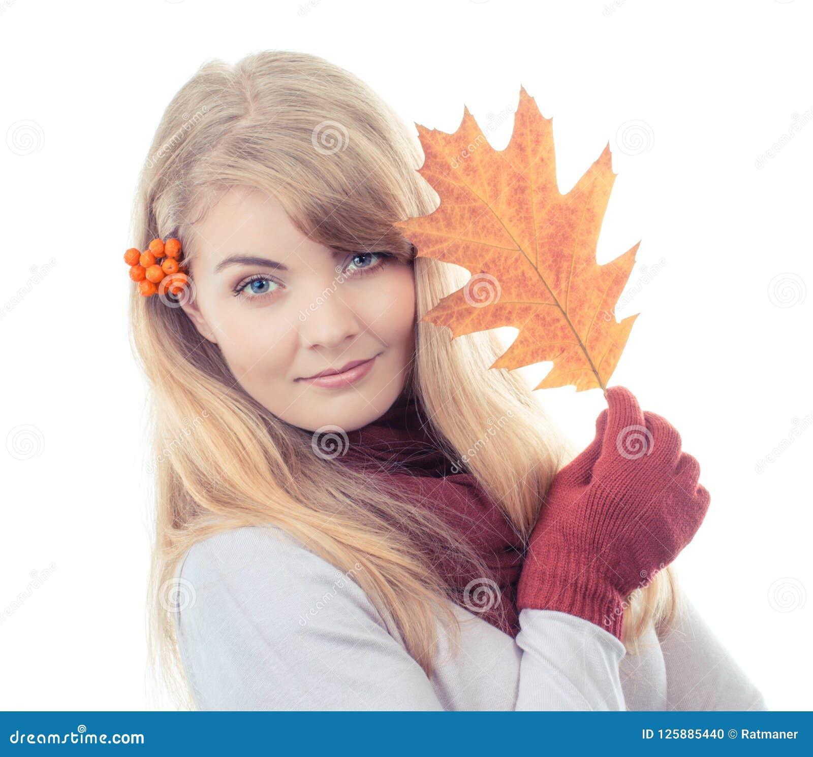 Vintage photo, Happy smiling girl in gloves holding autumnal leaf