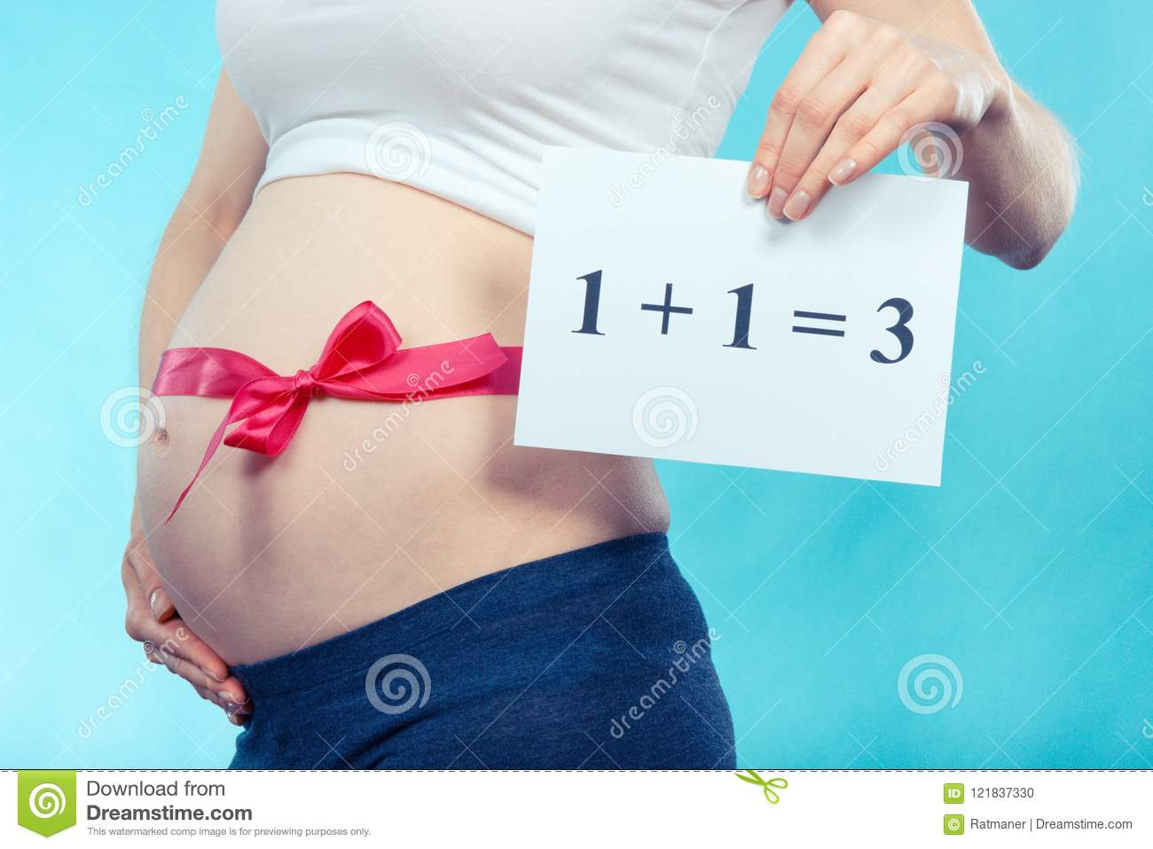 Vintage photo, Pregnant woman with pink ribbon on belly holding inscription 1+1=3, concept of extending family