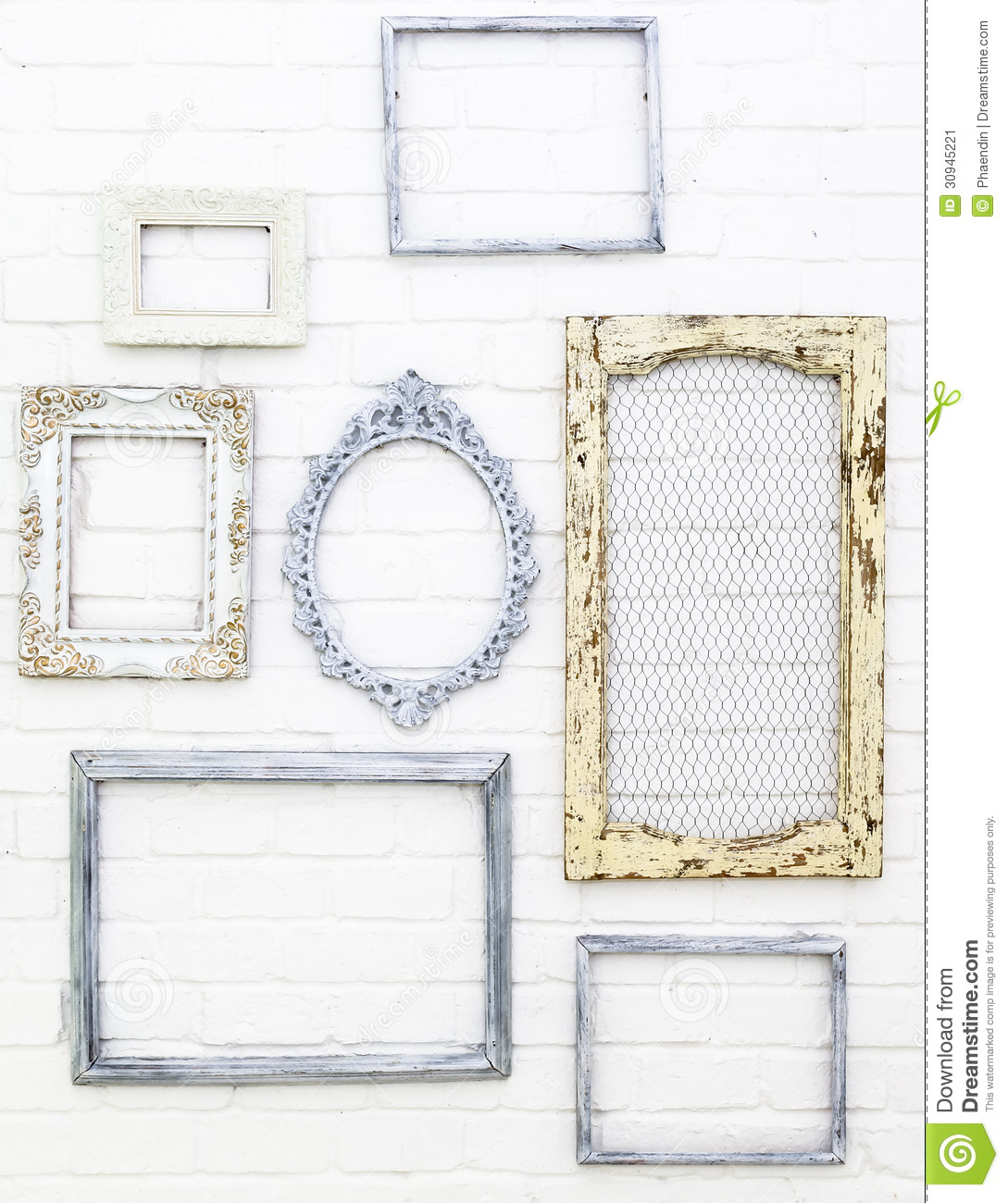 Vintage picture frames on white brick wall stock image for Decoracion para pared vintage