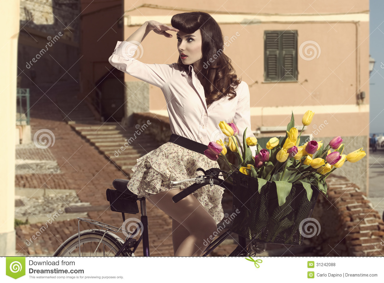 Vintage Pin Up With Flowers On Bike In Old Town Royalty