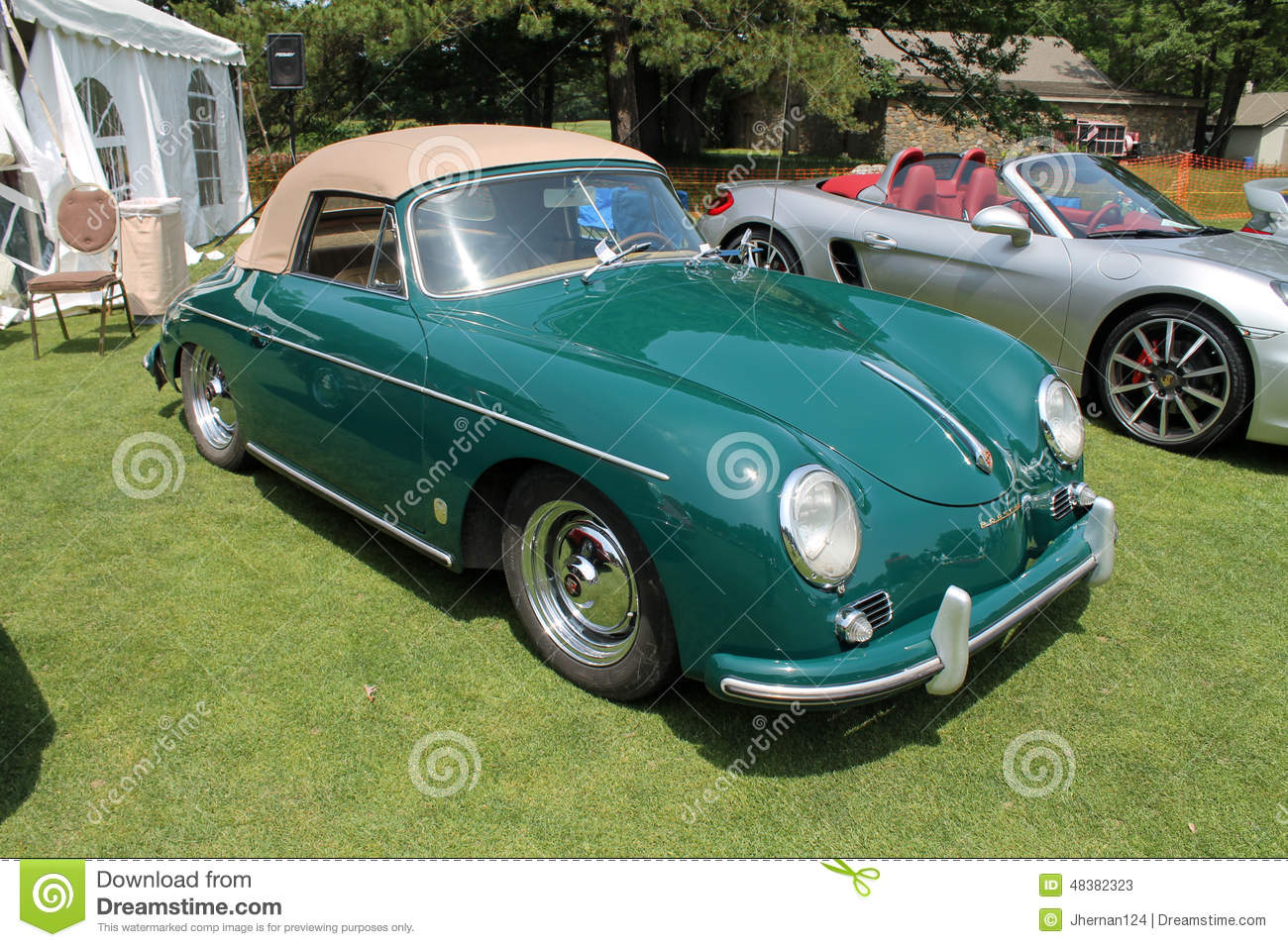 Classic gtrrn Porsche 356 cabrio sports car on display outdoors in a