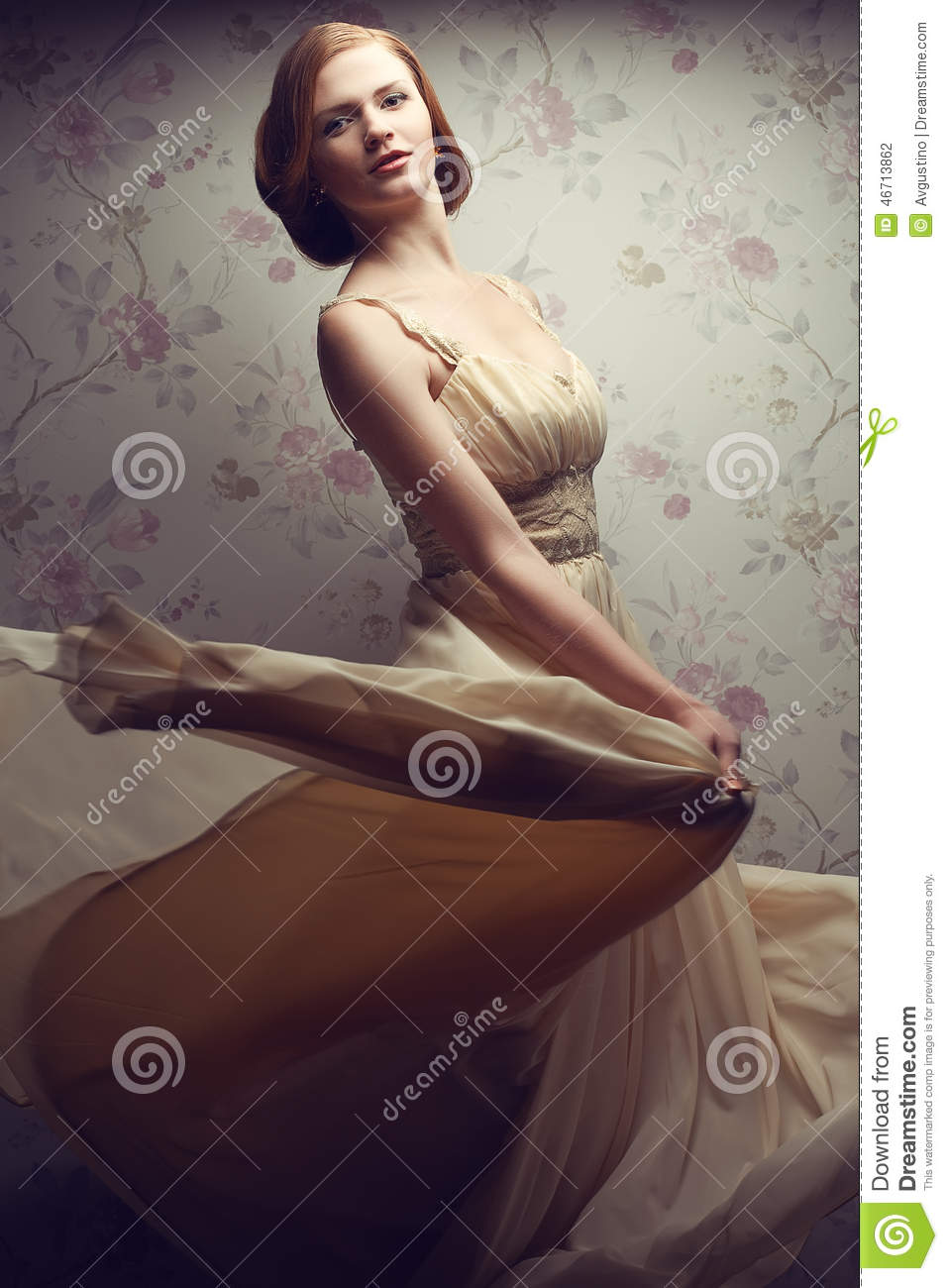 Vintage portrait of happy glamorous red-haired girl in cool dress