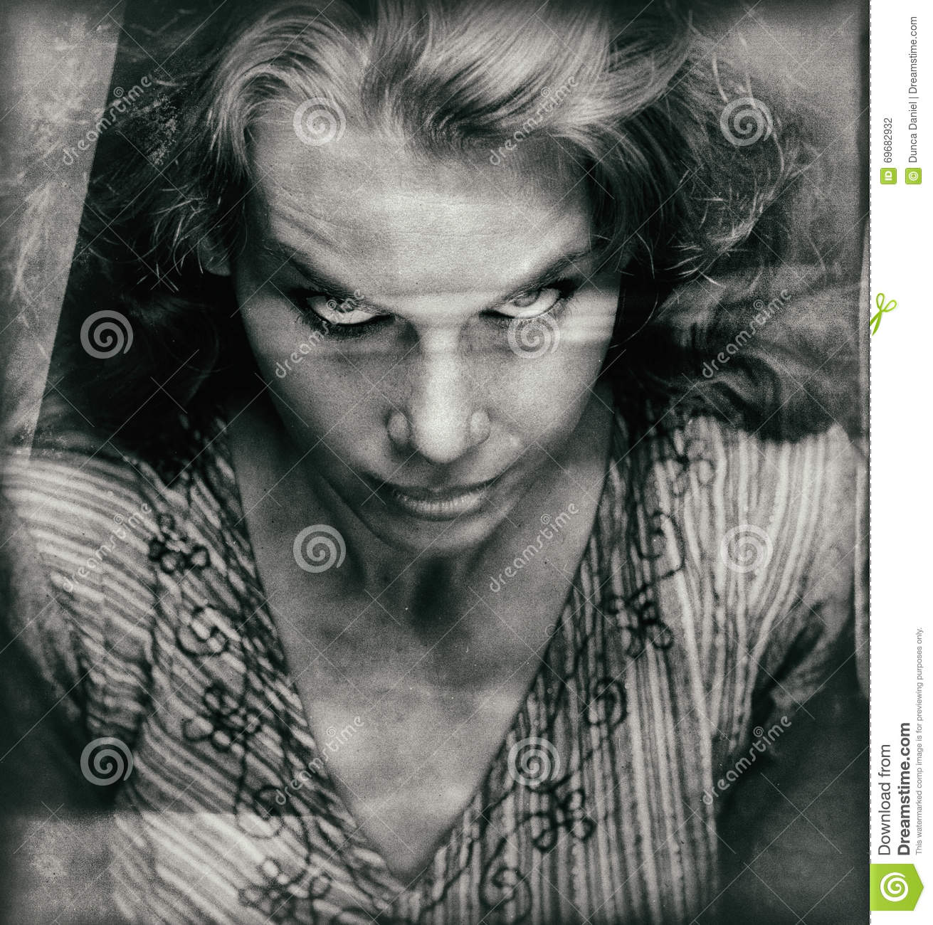 Vintage portrait of scary woman with evil face