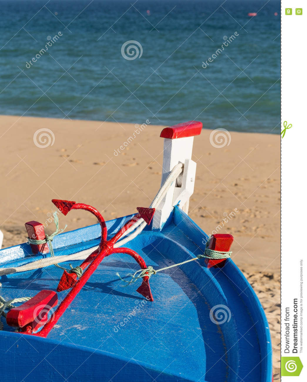 Vintage Portuguese Boat On Beach With An Anchor. Stock