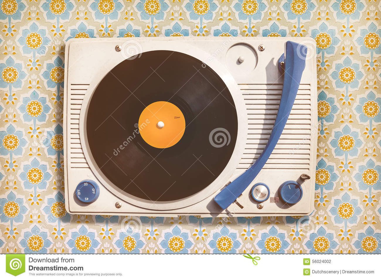 Vintage Record Player On Top Of Flower Wallpaper Stock