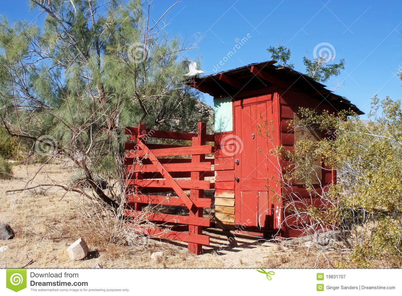 Vintage Red Outhouse in The Desert