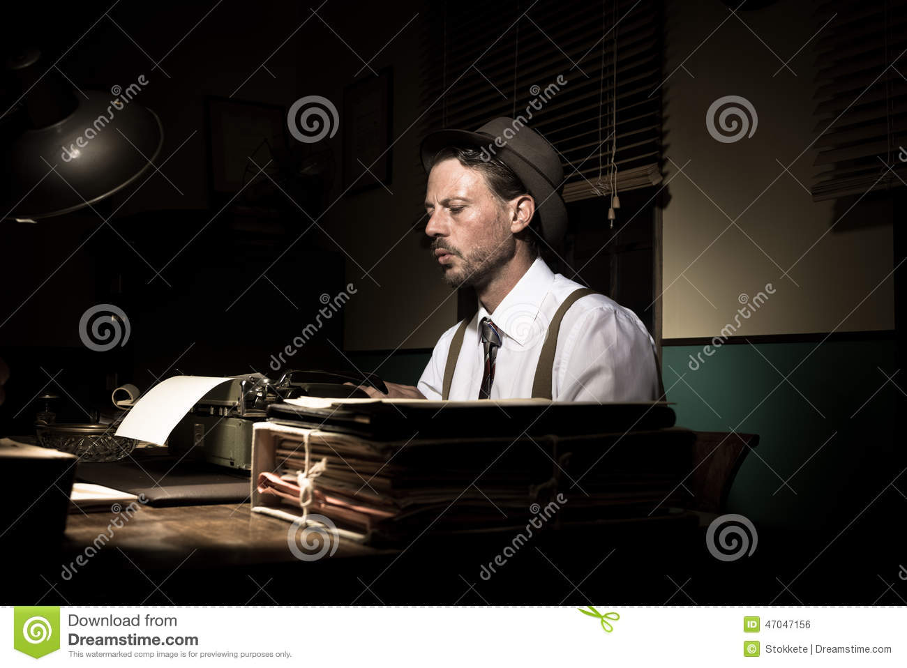 vintage reporter working late at night stock photo
