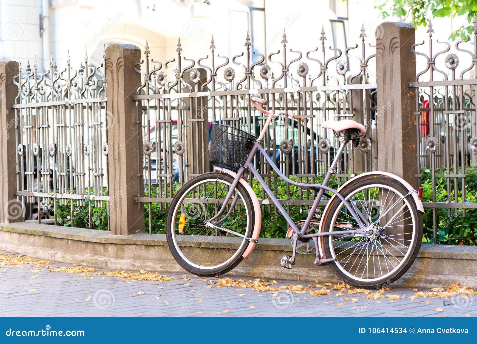 Vintage Retro Bicycle Near Metal Iron Fence  Outdoors  Stock Photo