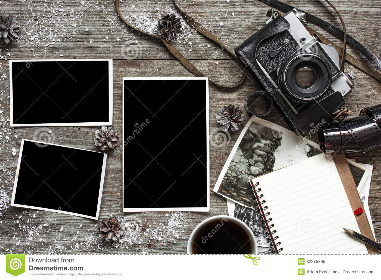 Vintage retro camera on wood table background covered with snow