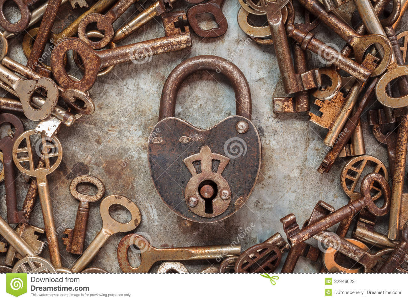Vintage Rusty Padlock Surrounded By Old Keys Stock Image