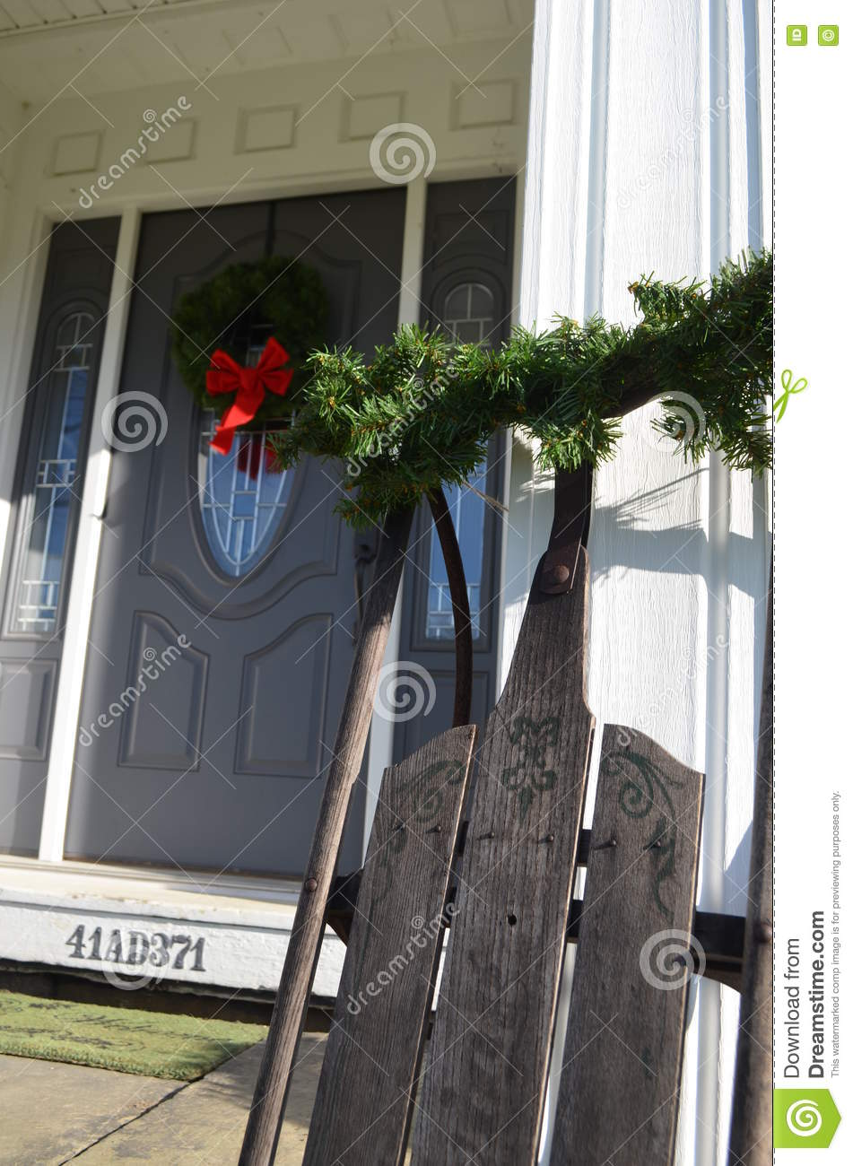download vintage sled and christmas decorations on house stock photo image of welcoming window - Vintage Sled Christmas Decoration