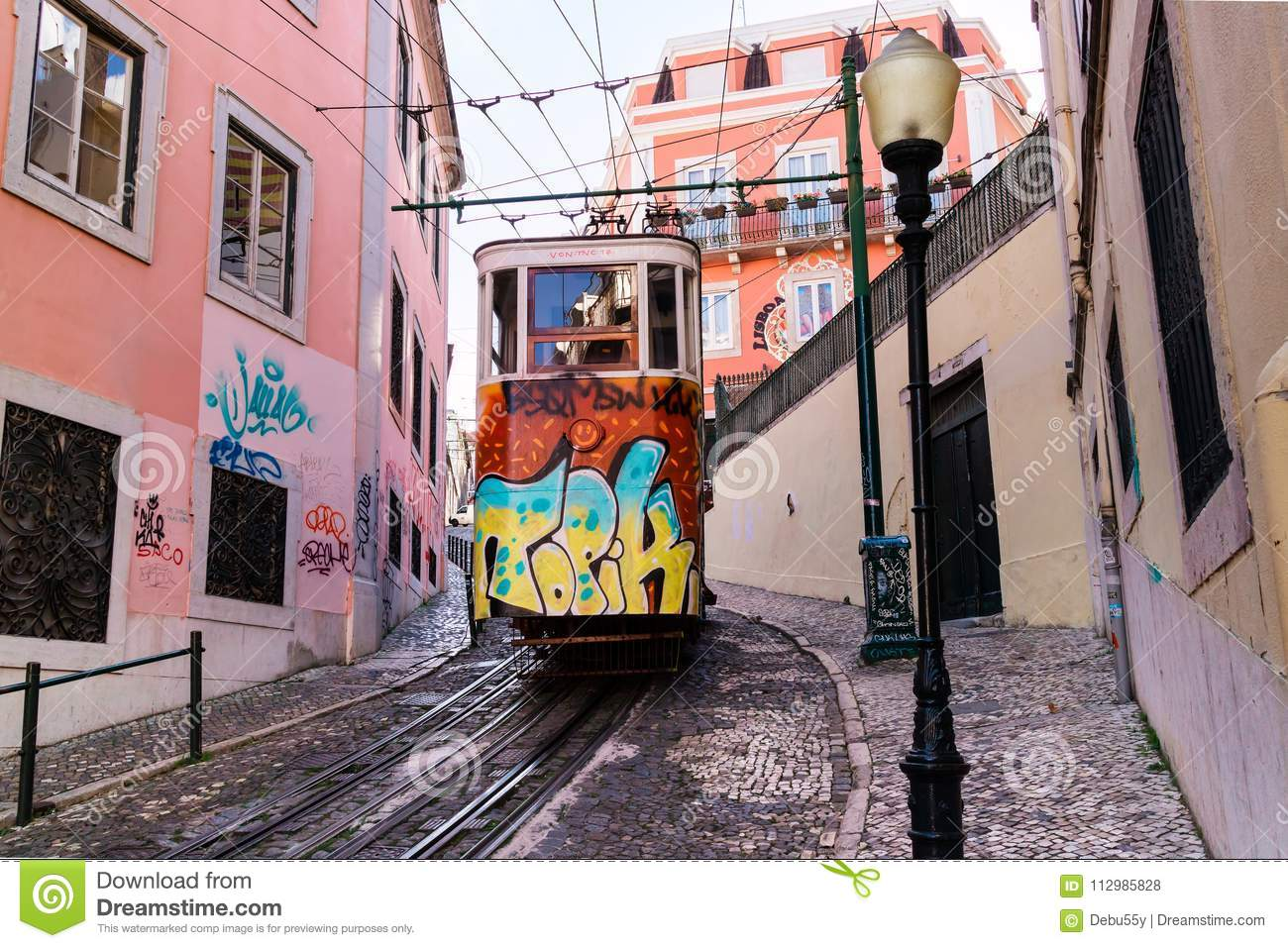 Vintage street car in the old city centre of Lisbon.