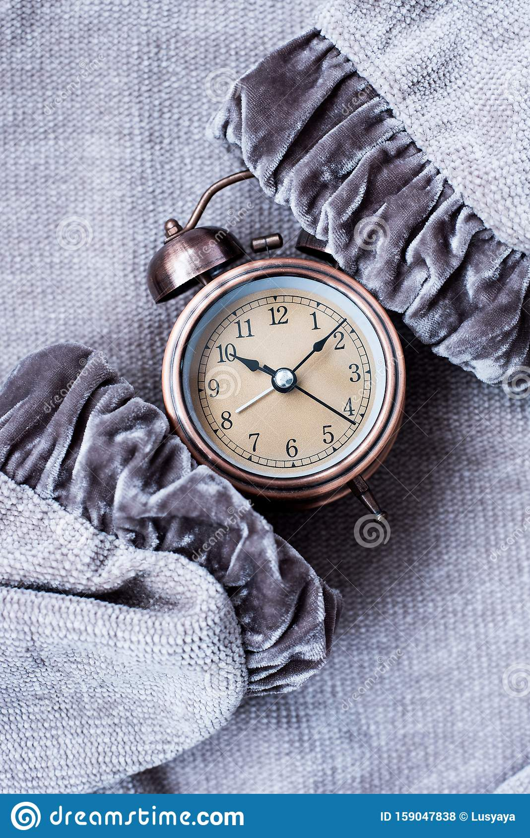 Vintage Style Alarm Clock On Knitted Background. Windup ...