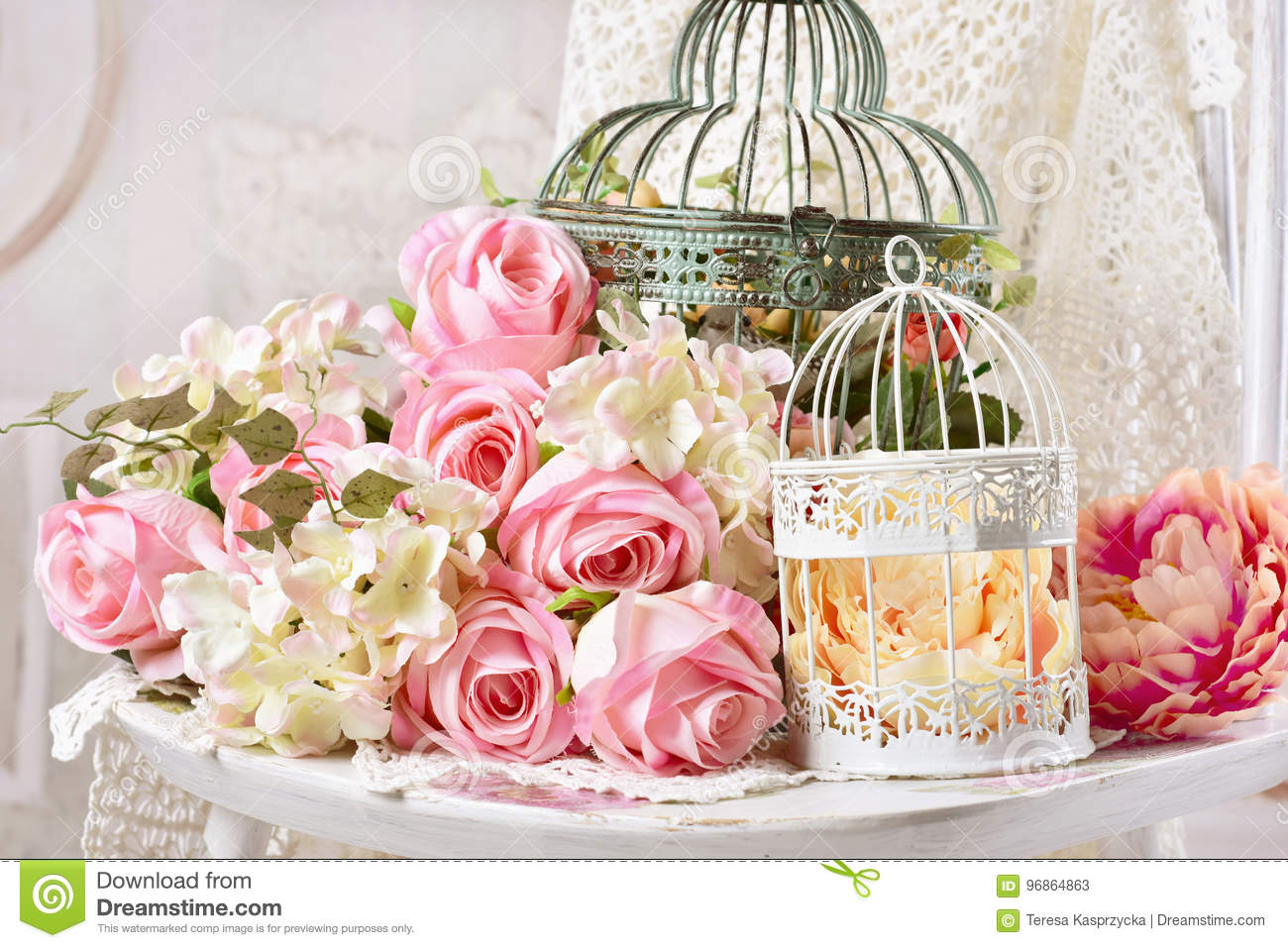 Vintage Style Decoration With Flowers In Old Bird Cages Stock Image