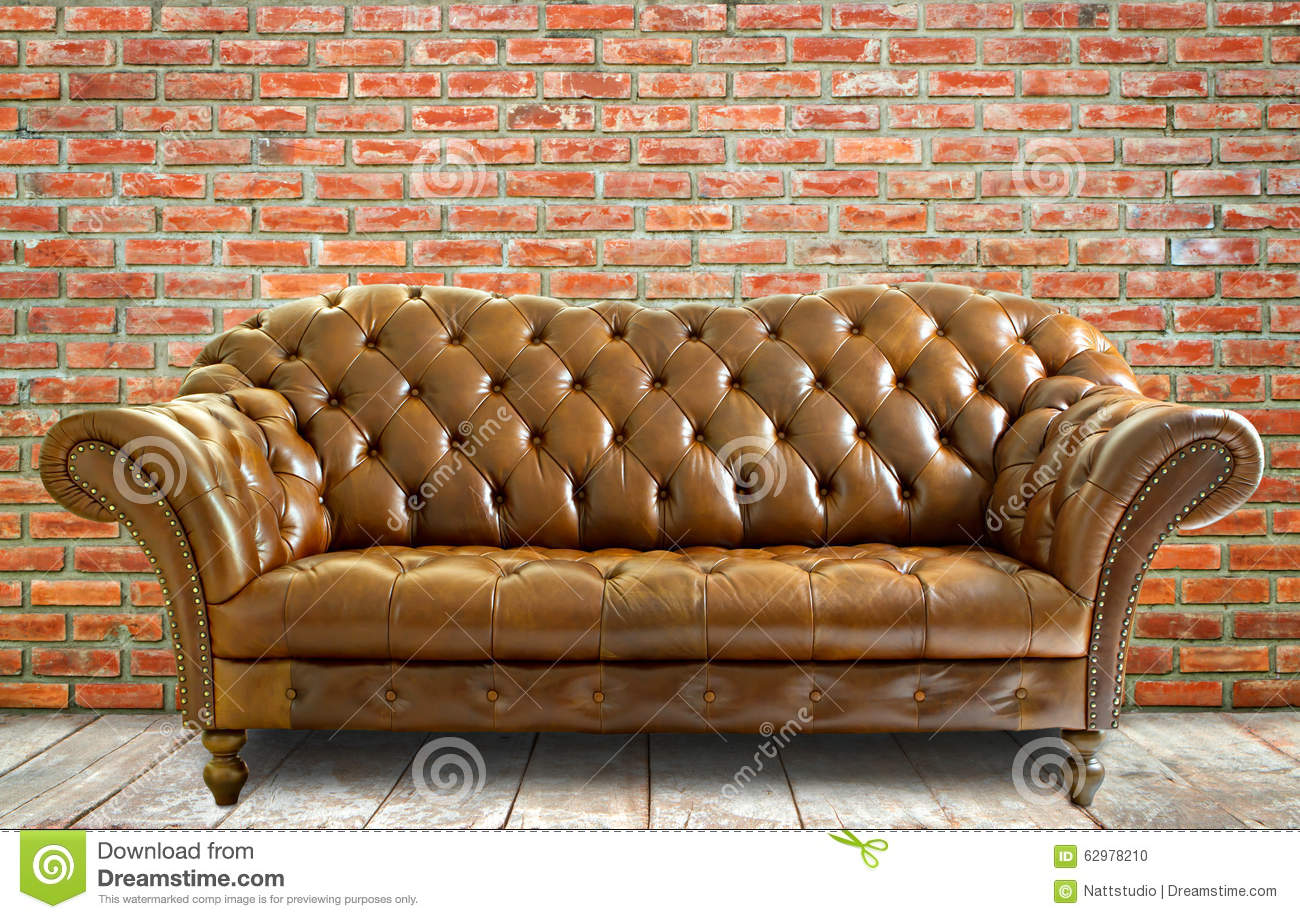 Vintage Style Leather Sofa With Wooden Floor And Brick Wall Stock  ~ Leather Sofa Vintage Style