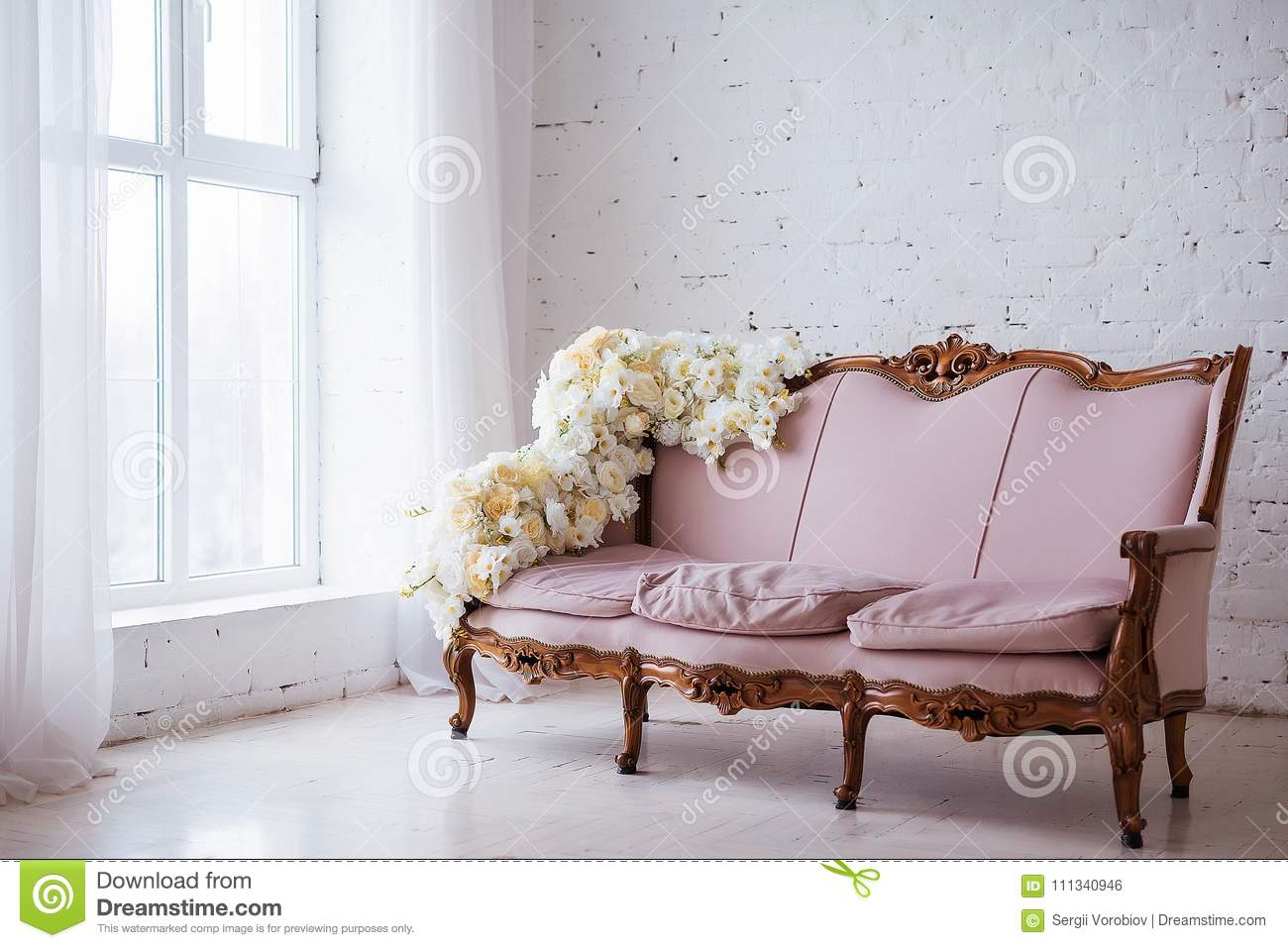 Vintage Style Sofa Decorated With Flowers In Loft Interior Room With