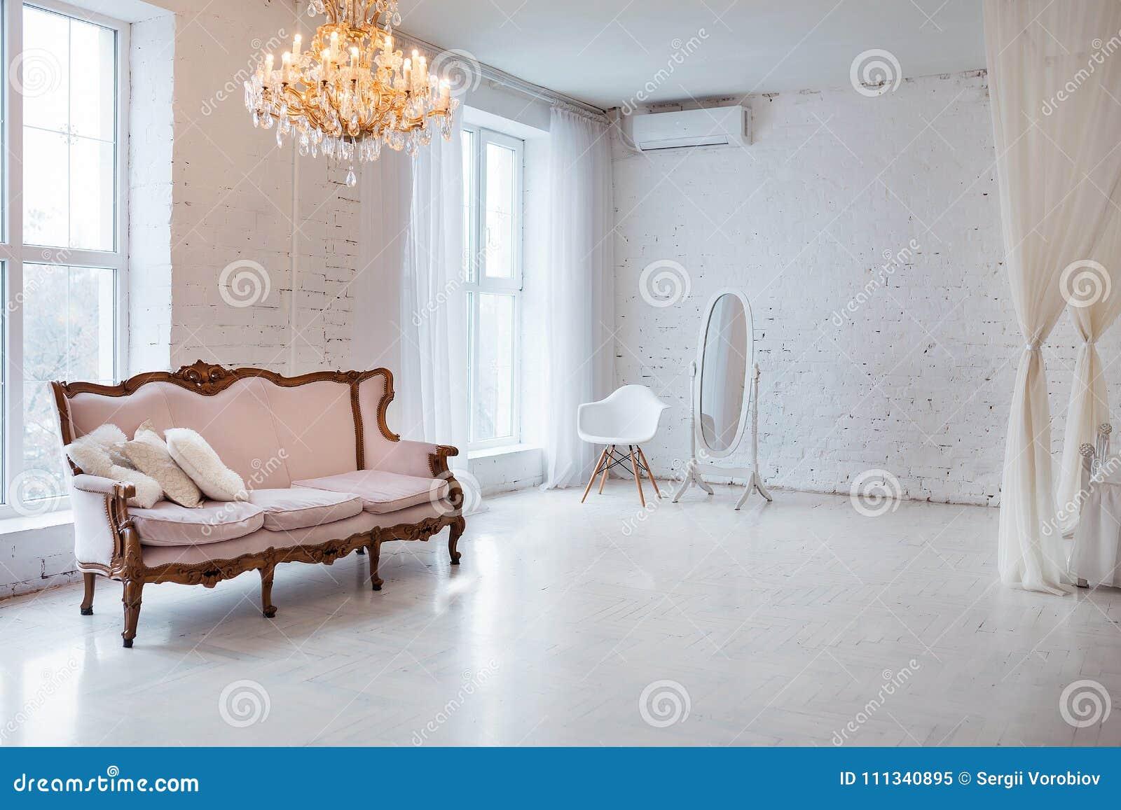 Vintage Style Sofa In Loft Interior Room With Big Window Stock