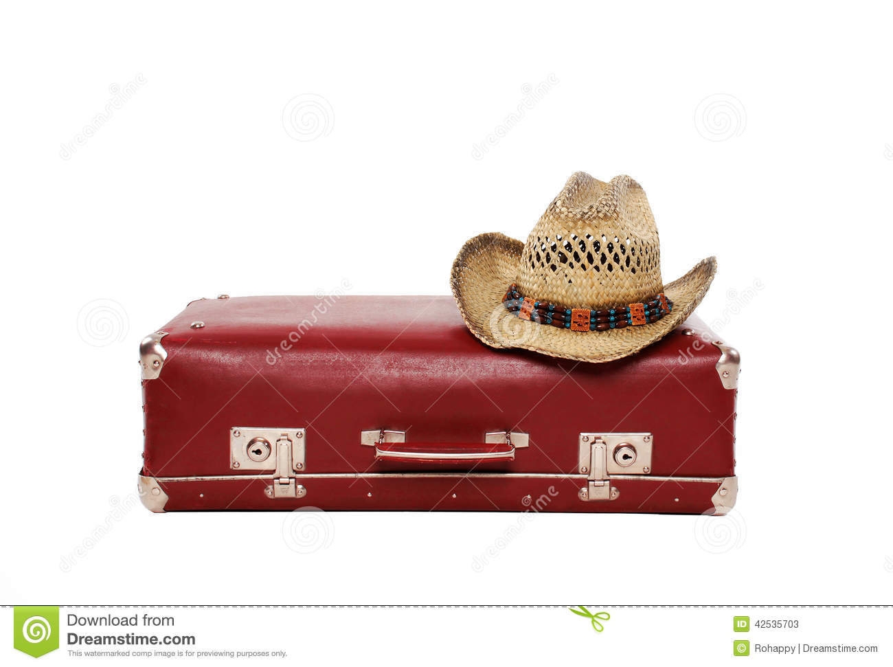 Vintage suitcase and straw hat