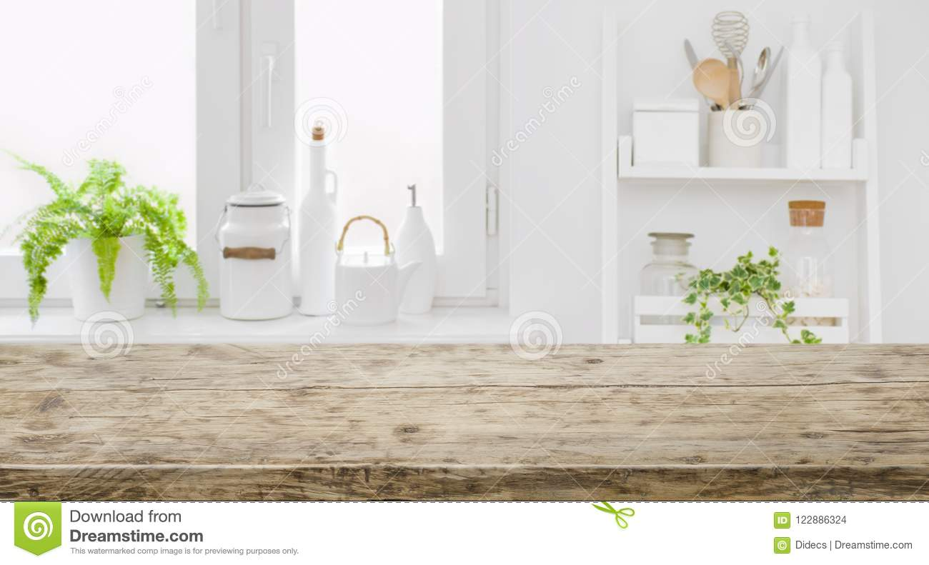 Vintage tabletop for product display with defocused modern kitchen background