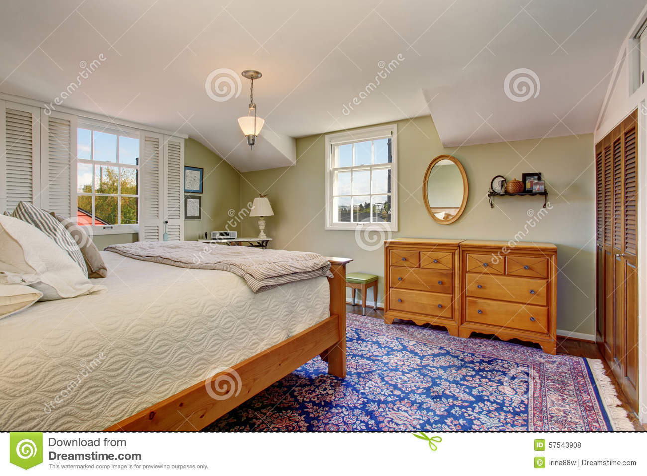 vintage themed bedroom with blue decorative rug and white bedding