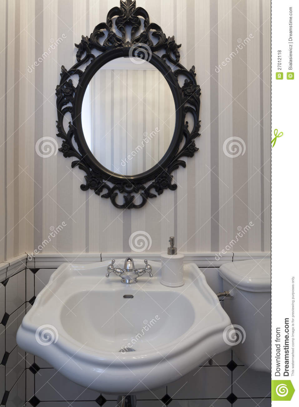 vintage toilet with a mirror royalty free stock photos image 27012118. Black Bedroom Furniture Sets. Home Design Ideas
