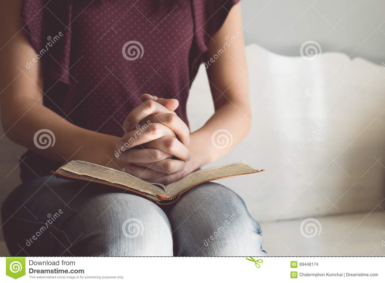 Vintage tone of woman hands on bible. she is reading and praying