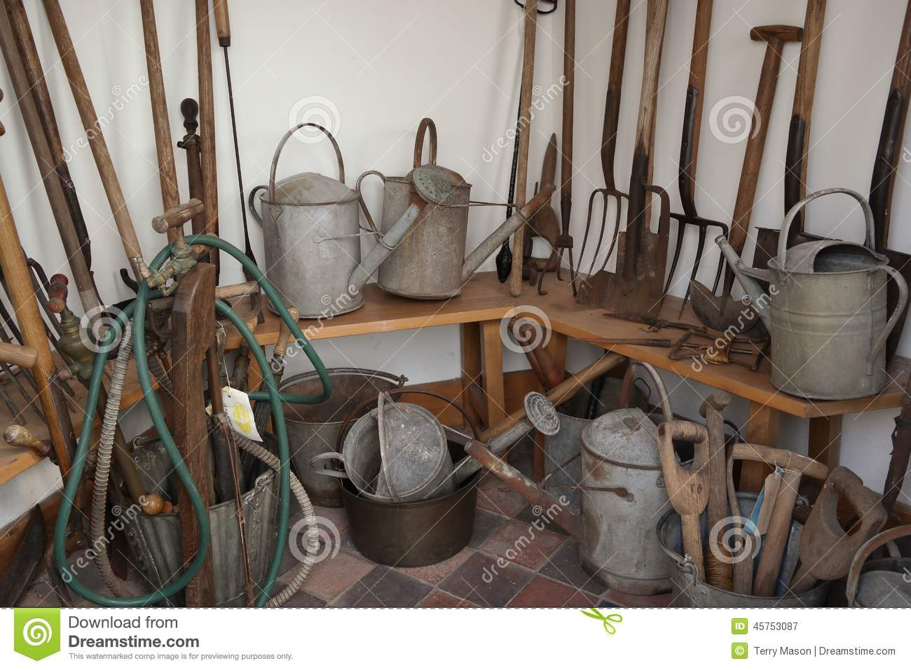 Vintage Tools In Brick Outhouse Royalty Free Stock Photography