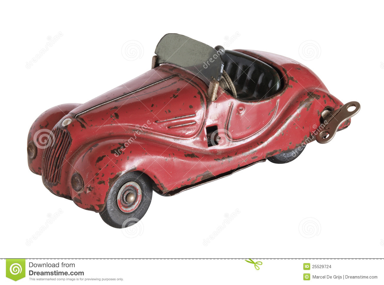 An old vintage toy car isolated on a white background.