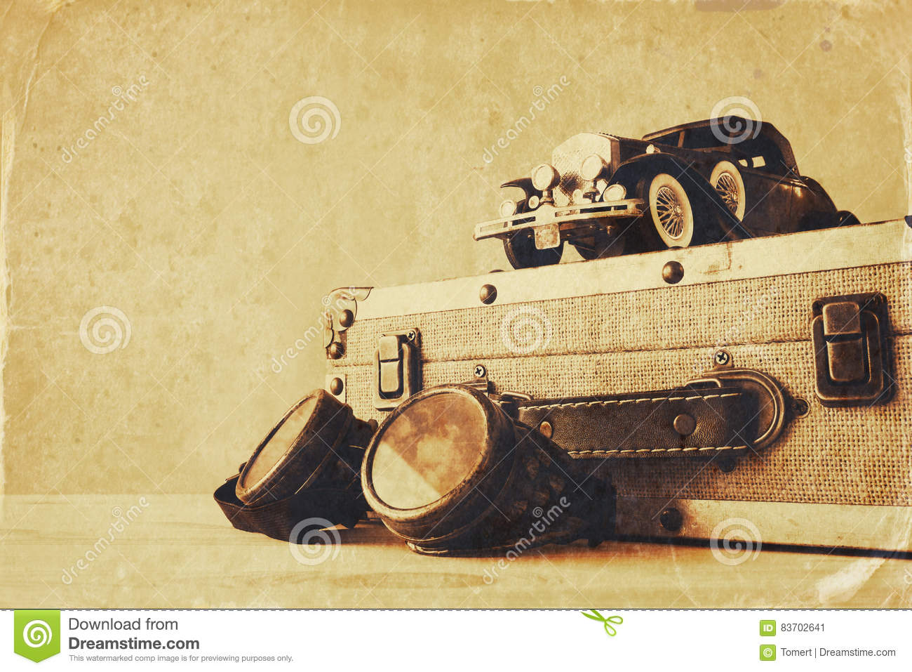 Vintage Toy Car And Old Suitcase Next To Pilot Glasses Stock Photo