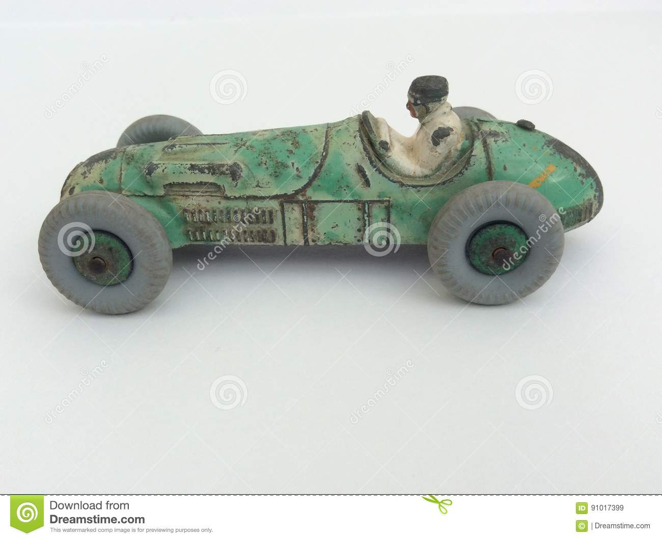 Vintage Toy Racing Car And Driver Worn Green Paint On A White Background With Copy Space Stock Image Image Of Left Automobile 91017399