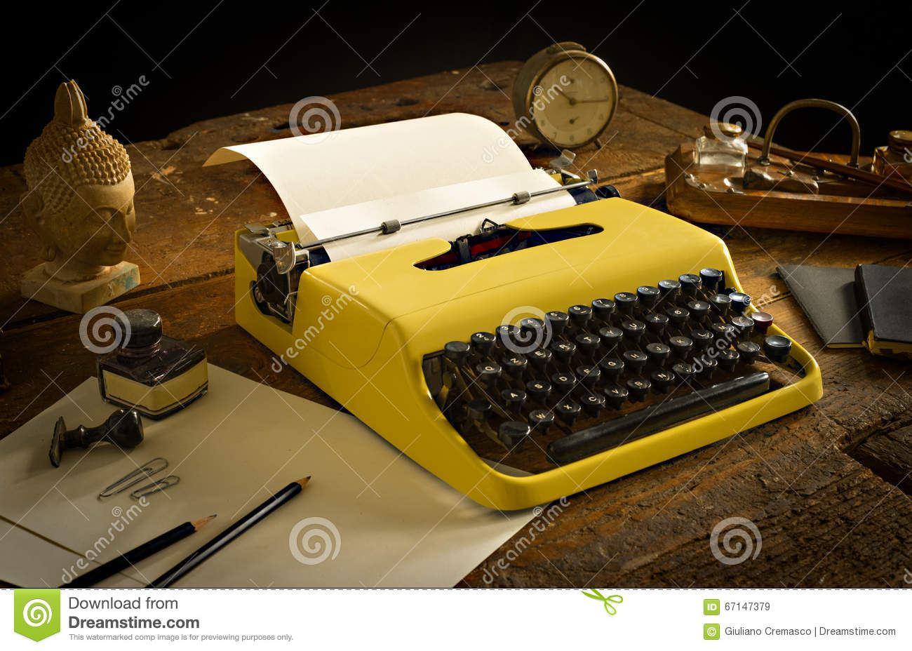 Vintage typewriter above an old wooden desk with old stationary