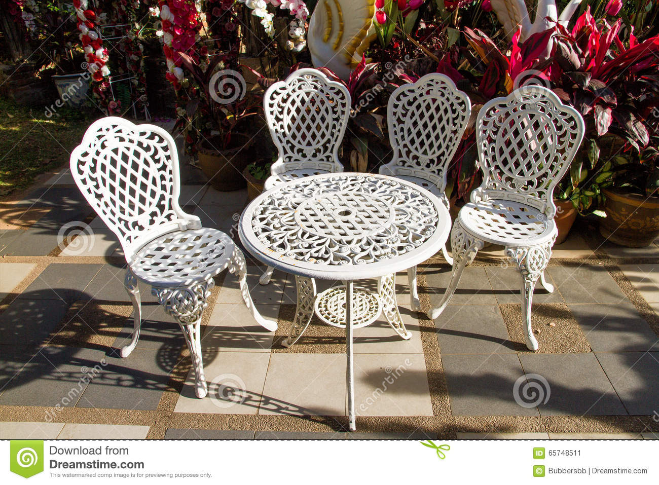 white iron table and chairs