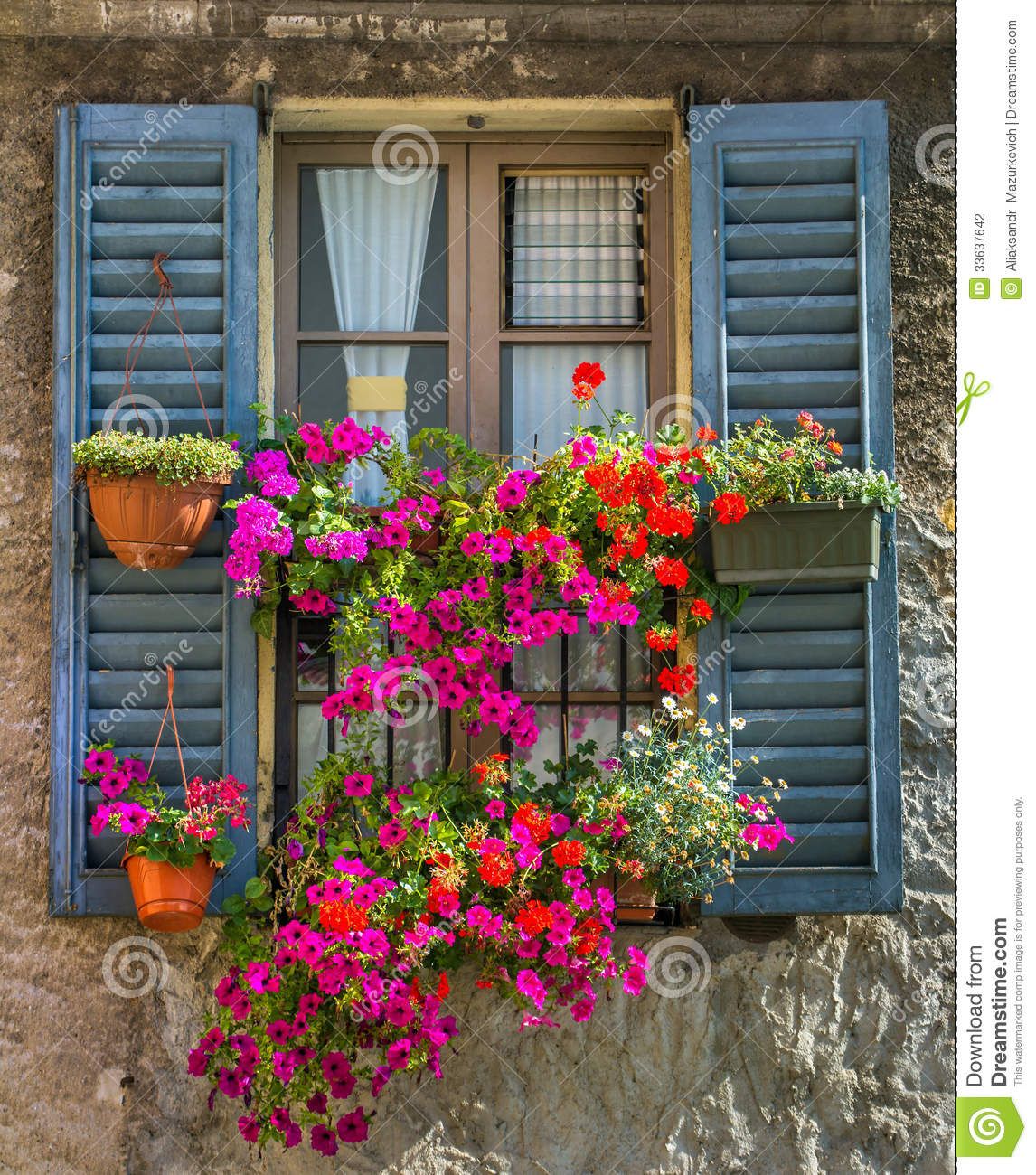 Exterior windows with shutters - Vintage Window With Fresh Flowers Stock Photography
